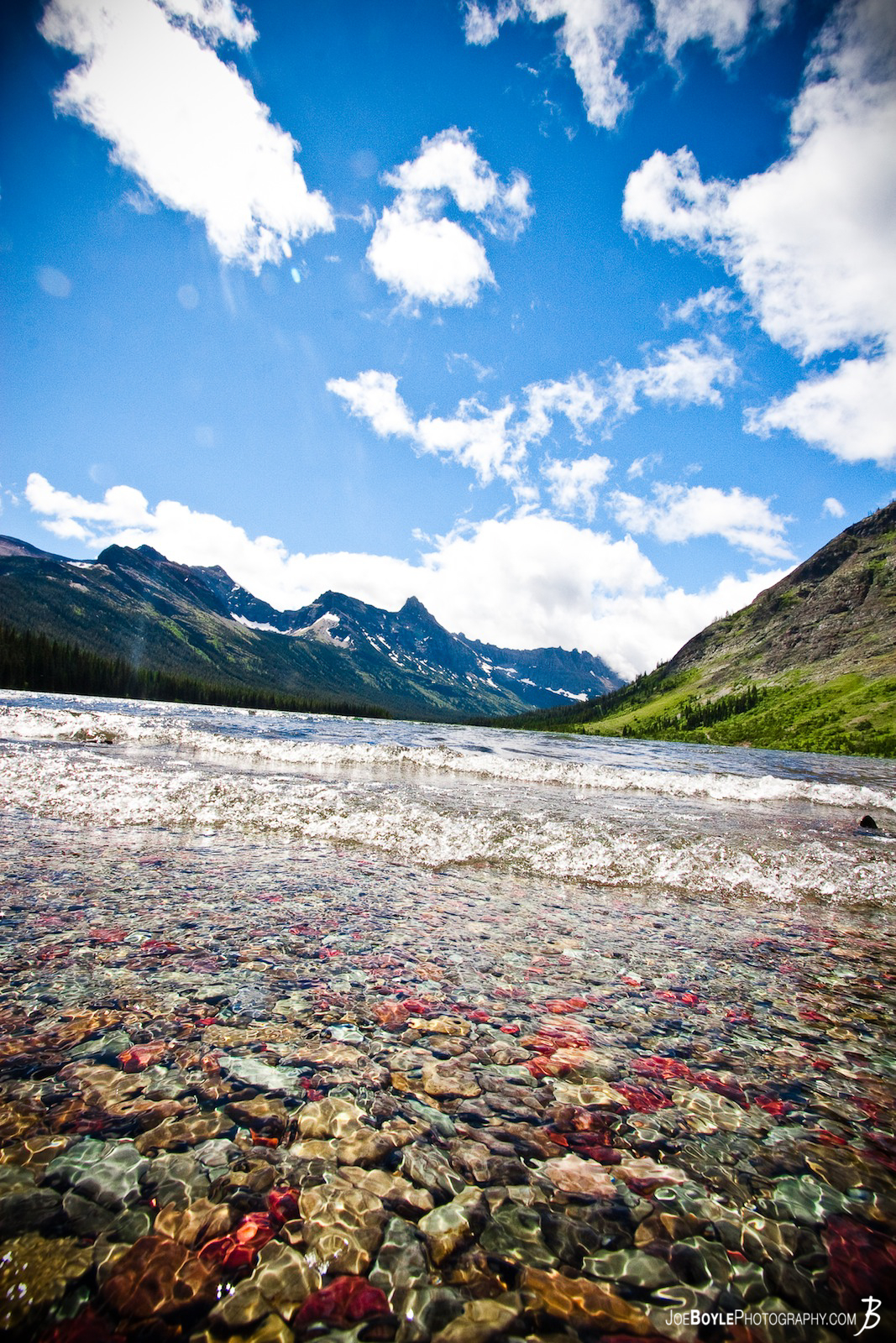 I captured this image of a Lake in Glacier National Park (GNP). I really liked how clear the water was and the colorful stones that were so close to shore! The water was cold!