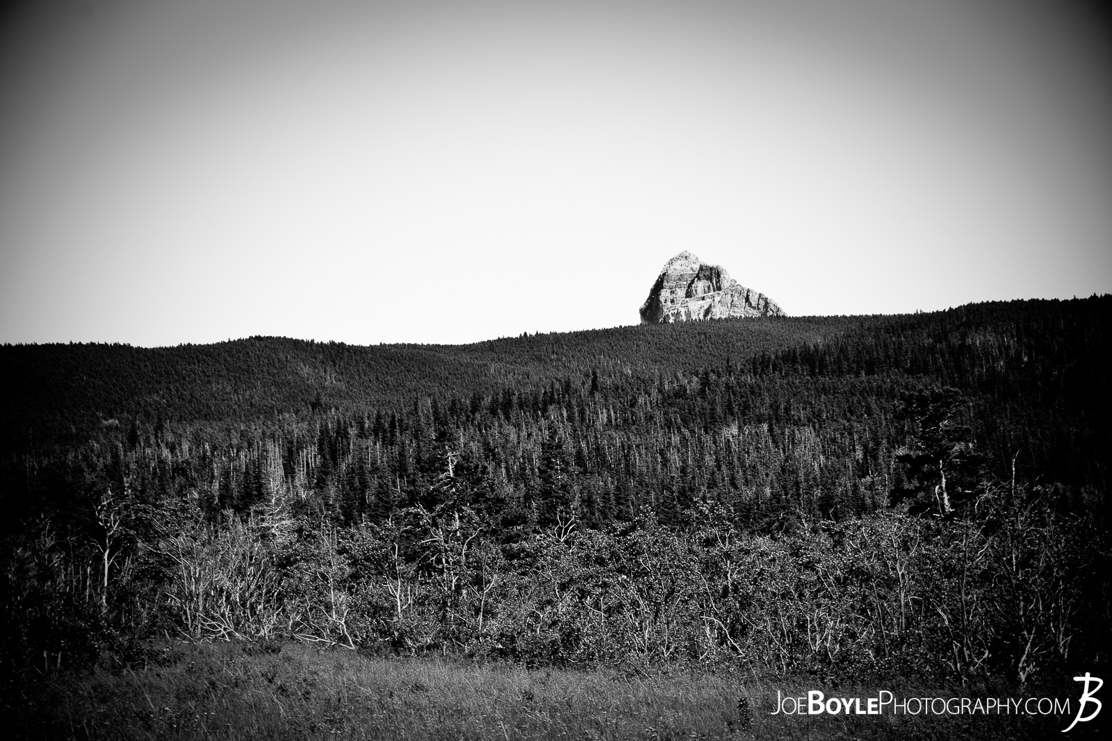 As I was hiking through Glacier National Park I stopped and looked up, (because I'm often staring at the ground making sure I don't step on a rock or twist my ankle), and I saw this iconic looking rock just sitting off in the distance.
