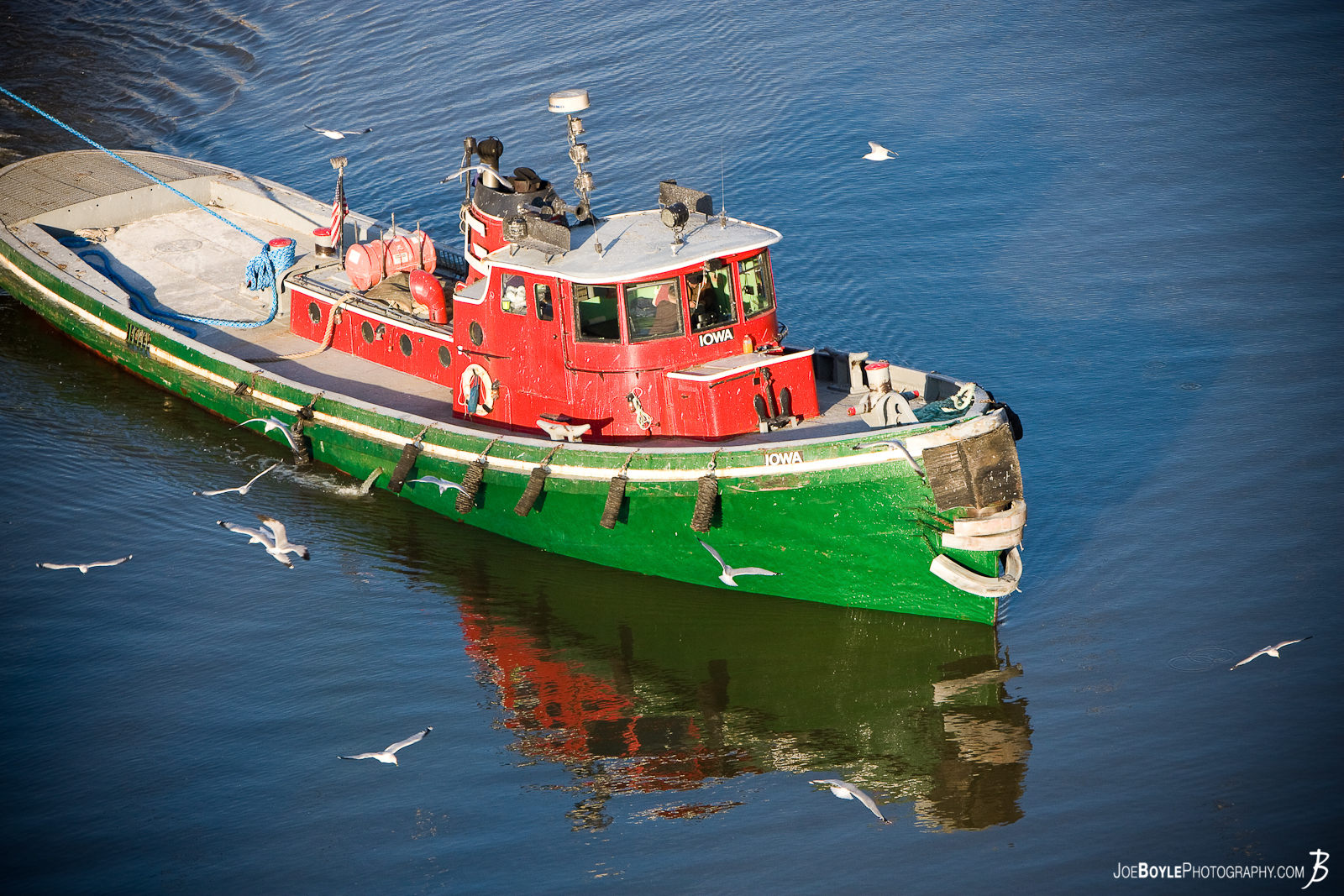 "I took this tugboat photo from the Hope Memorial Bridge. This little guy was pulling a huge boat behind him - naturally. I like to call this picture ""Merry Christmas Tugboat"" for it's bright red and green colors."
