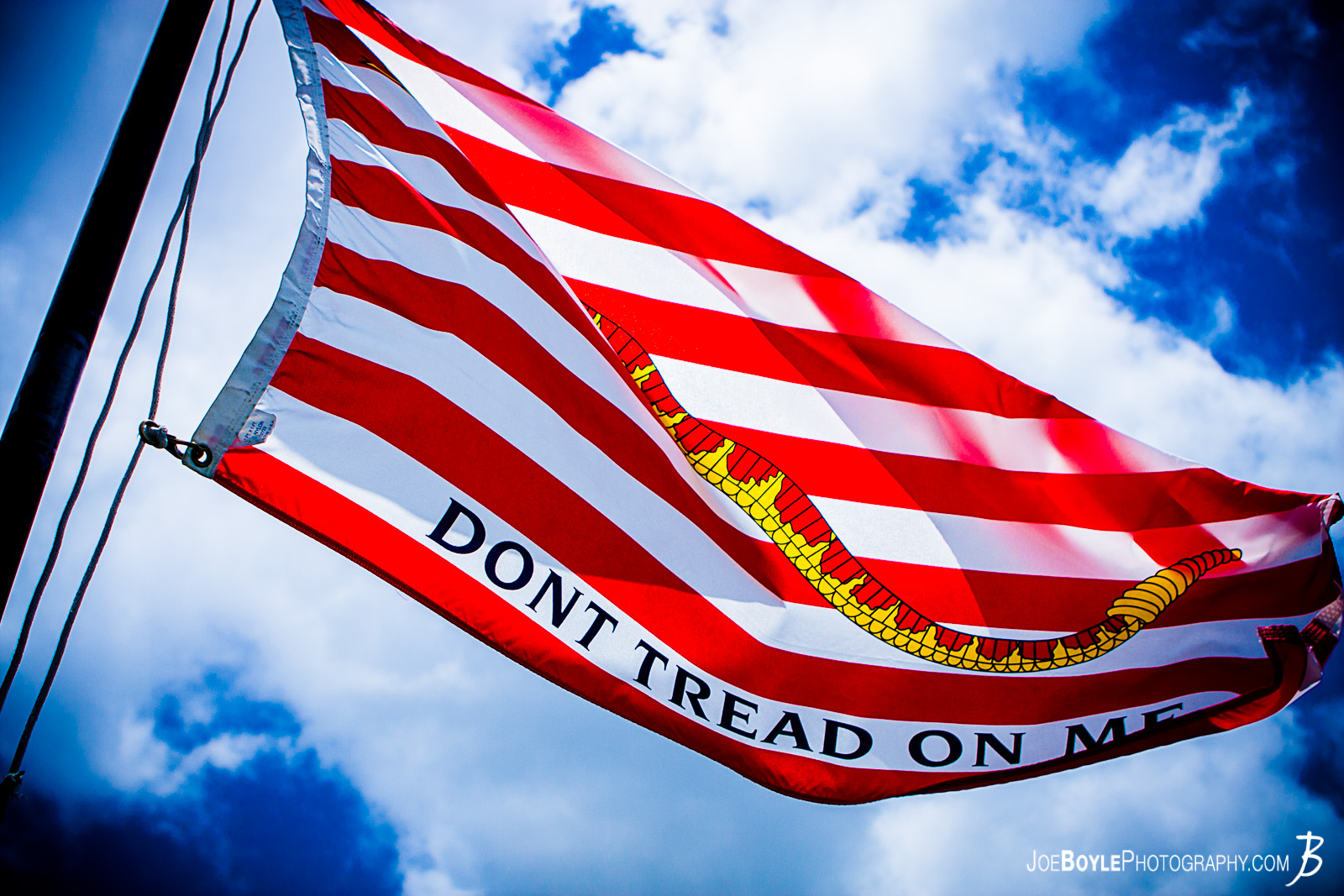 "While on a trip to Hawaii I made a visit to Pearl Harbor on Oahu. I was able to capture a photo of the American Flag that now flys aboard this vessel, the U.S.S Bowfin submarine. This vessel lived through a traumatic era of American History and this flag with, ""Don't Tread on Me"" epitomizes the American attitude during World War II."