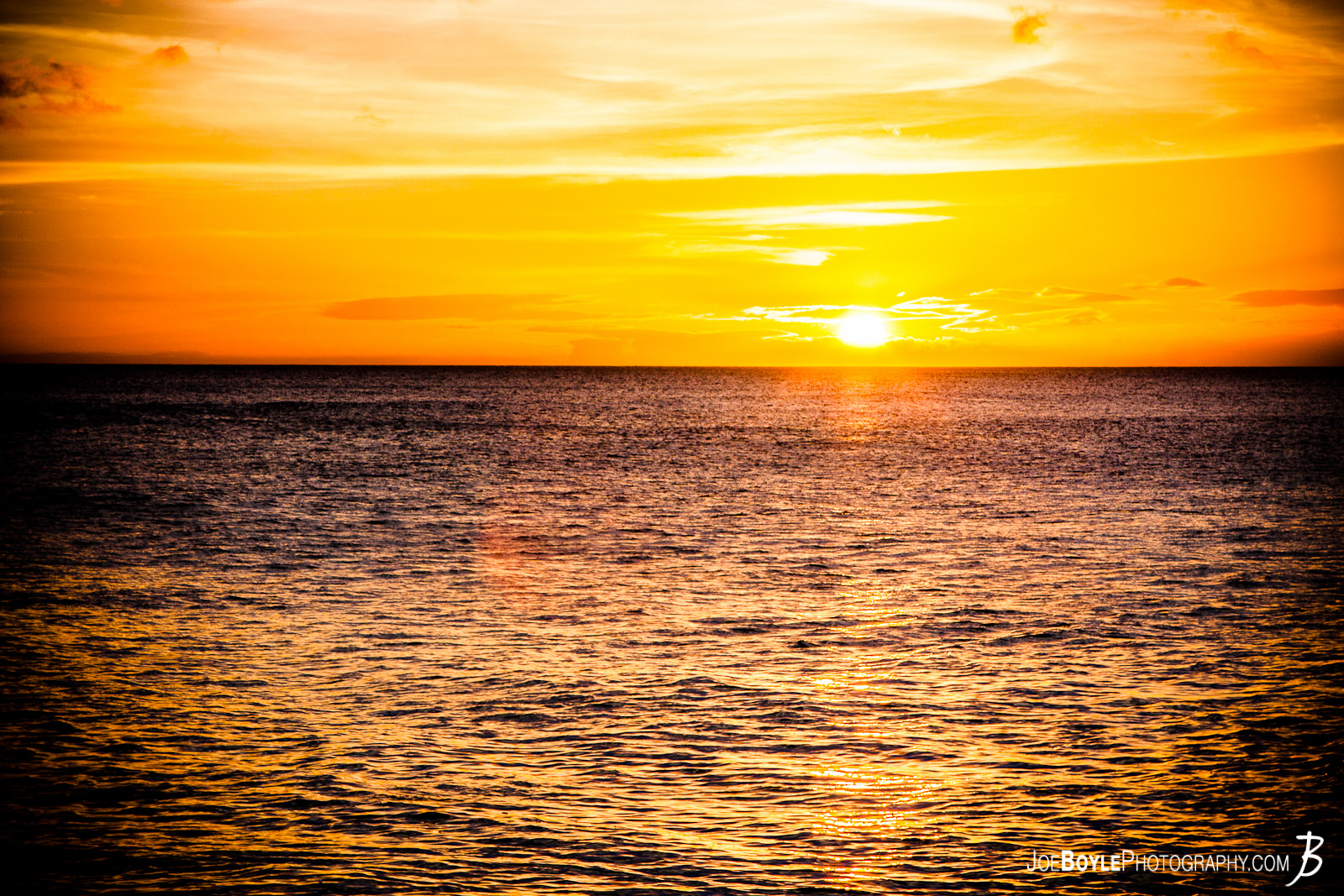 While staying at the Aulani Disney Resort, I ventured out one evening to hopefully capture some beautiful images of the sunset over the Pacific Ocean and I came back with this image!