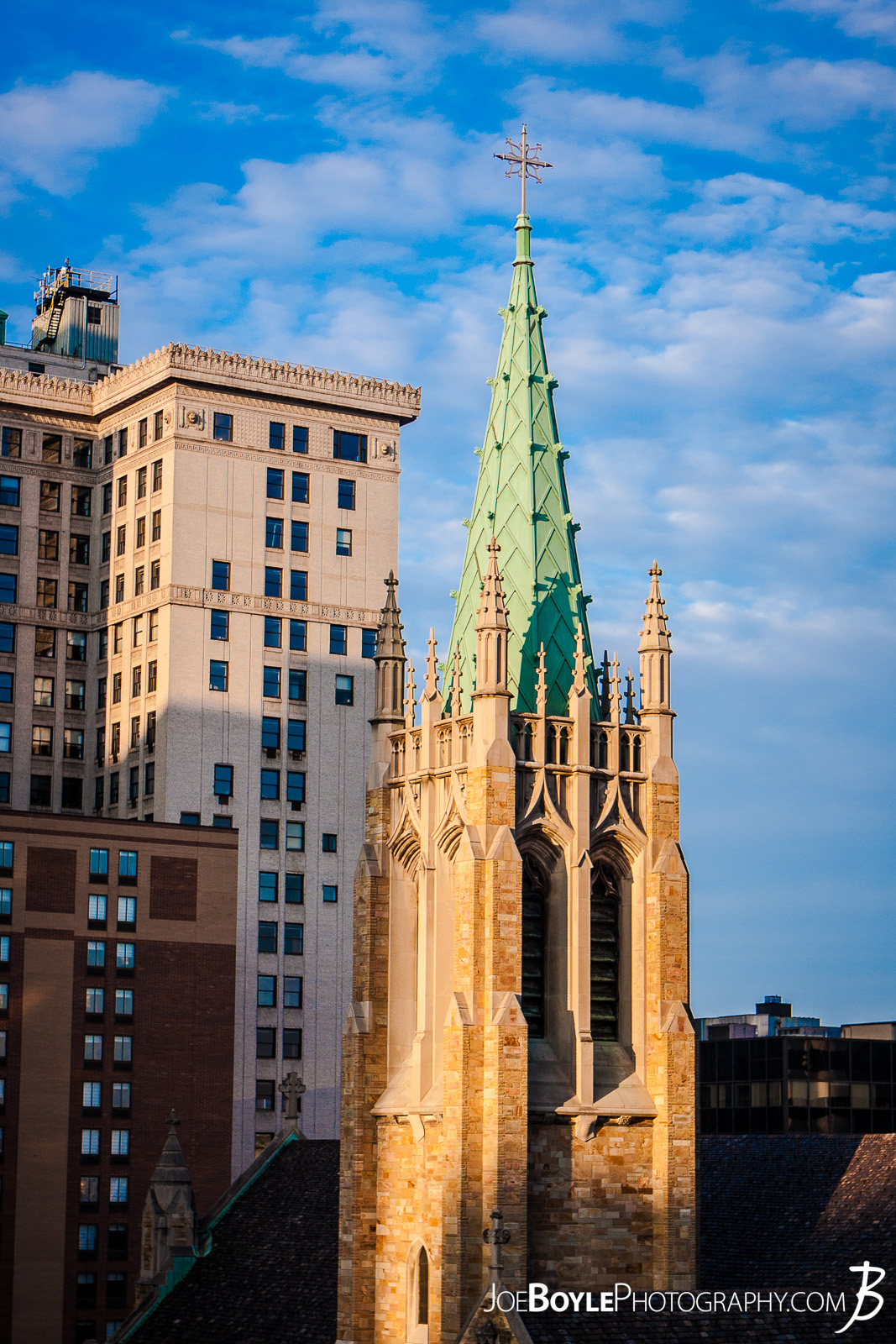 Saint Johns Cathedral in Downtown Cleveland Ohio! I took this photo when I was actually on assignment for another photoshoot. That photoshoot was in an office to an adjacent building. I took this photo after I parked on the top level of a parking garage.