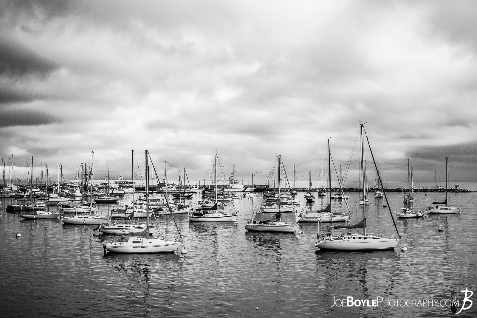 When I was traveling to Monterey, California I spent a lot of time just walking around the city, Pacific Grove and the sand dunes in the area. This is a shot of the bay and sailboats near Fisherman's Wharf and Cannery Row in Monterey!