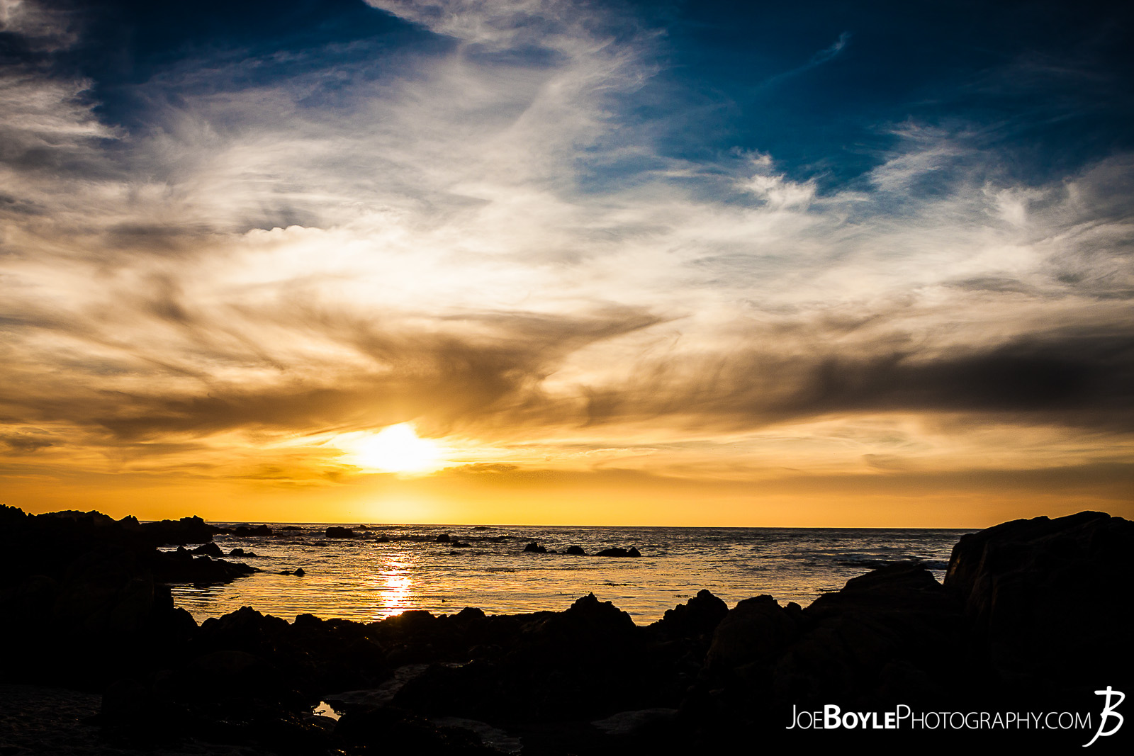 When I was traveling to Monterey, California I spent a lot of time just walking around the city, Pacific Grove and the sand dunes in the area. Here is a shot of a beautiful, golden sunset in Pacific Grove!