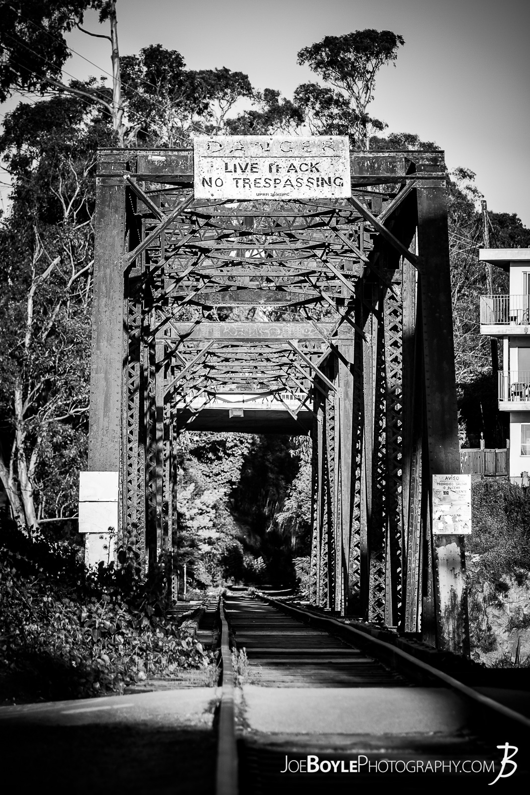 "While I was visiting a friend in Monterey, California we stopped over at the Santa Cruz Beach and Boardwalk. This cool looking bridge was nearby! Don't worry, I didn't venture too far with the ""Live Track - No Trespassing"" sign. ;)"