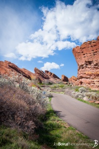 red-rocks-in-colorado-canyon-with-road-portrait