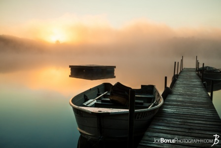 calm-misty-lake-with-pier-and-boats-boat-close