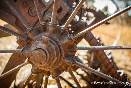 close-up-of-abandoned-farming-equipment-on-the-west-rim-trail-in-zion-national-park-wheel-spokes-axle-color