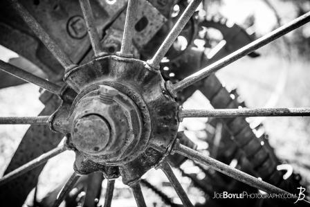 close-up-of-abandoned-farming-equipment-on-the-west-rim-trail-in-zion-national-park-wheel-spokes-axle-black-white