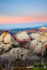 canyons-mountain-peaks-and-valleys-during-a-sunrise-in-zion-national-park-portrait