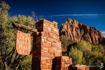 entrance-sign-of-zion-national-park-with-canyon-in-the-background