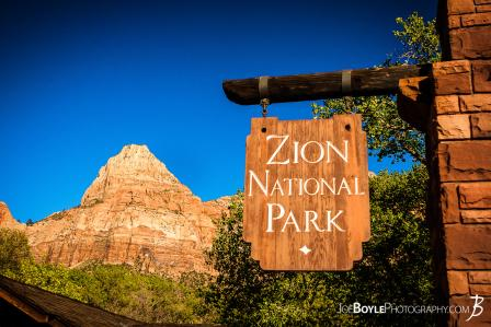 entrance-sign-of-zion-national-park-with-canyon-in-the-background-ii