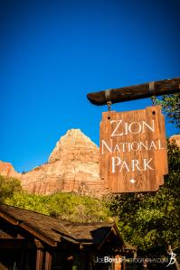 entrance-sign-of-zion-national-park-with-canyon-in-the-background-ii-portrait