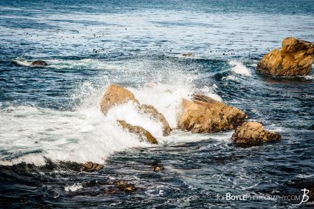 waves-splashing-and-gushing-through-rocks-on-seventeen-mile-drive-in-monterey-california