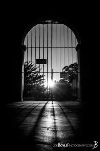 gate-at-carmel-mission-basilica-black-white