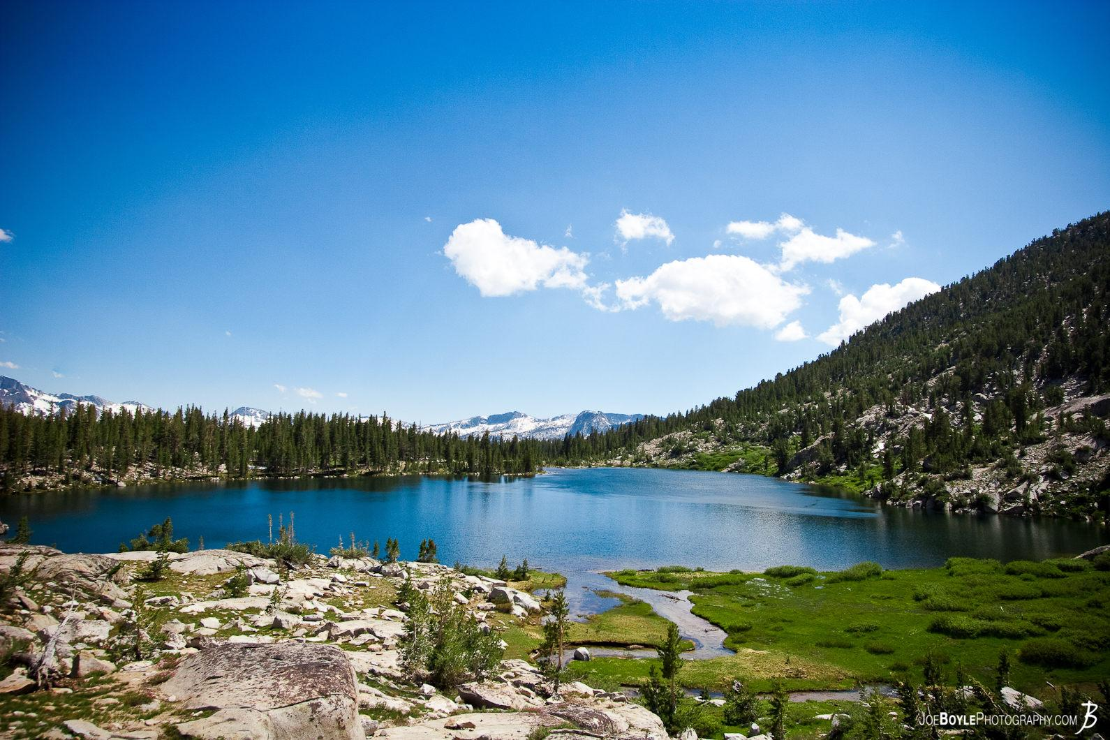 blue-lake-green-field