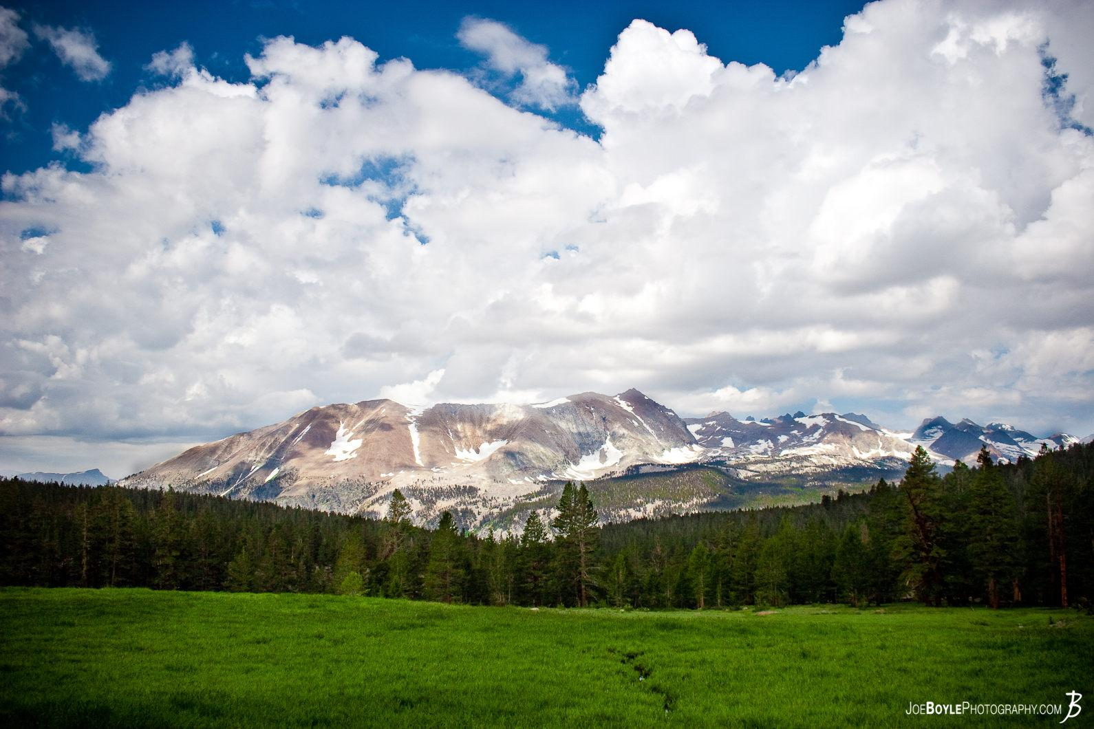 green-field-clouds-mountain