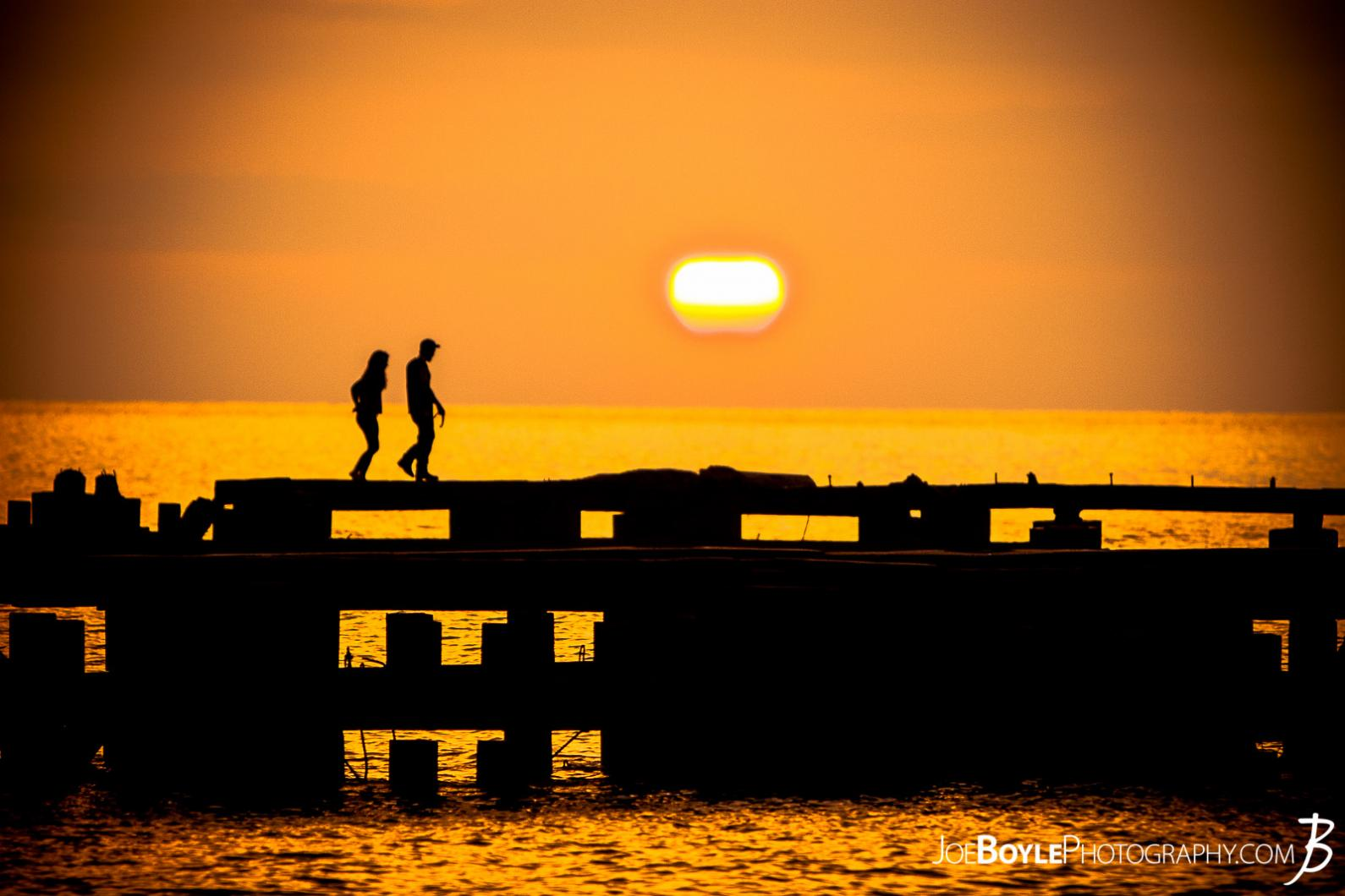 sunset-in-cleveland-off-of-lake-erie-people-on-a-pier