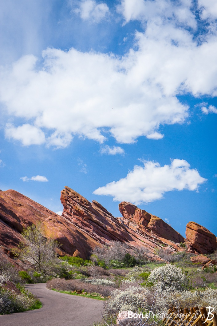 red-rocks-in-colorado-canyon-with-road-big-sky