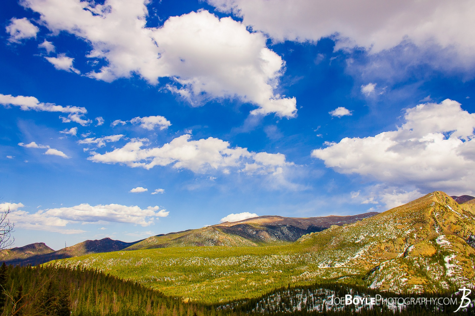 rocky-mountain-range-green-hillside