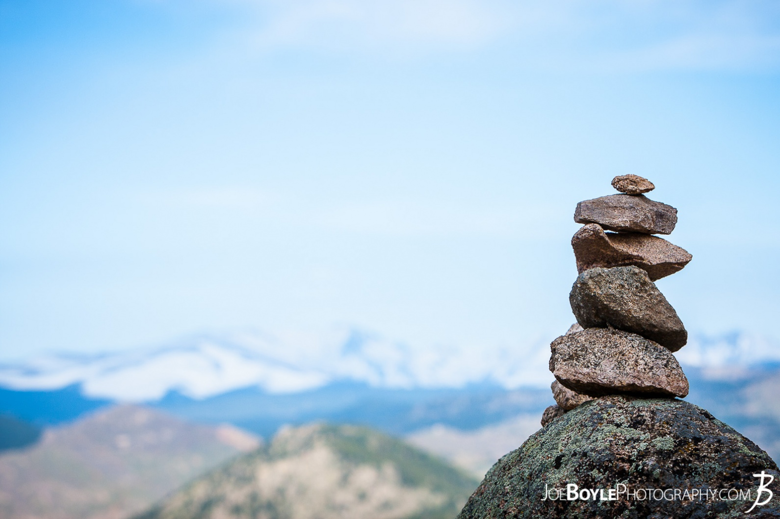 rocky-mountains-with-a-cairn-in-the-foreground
