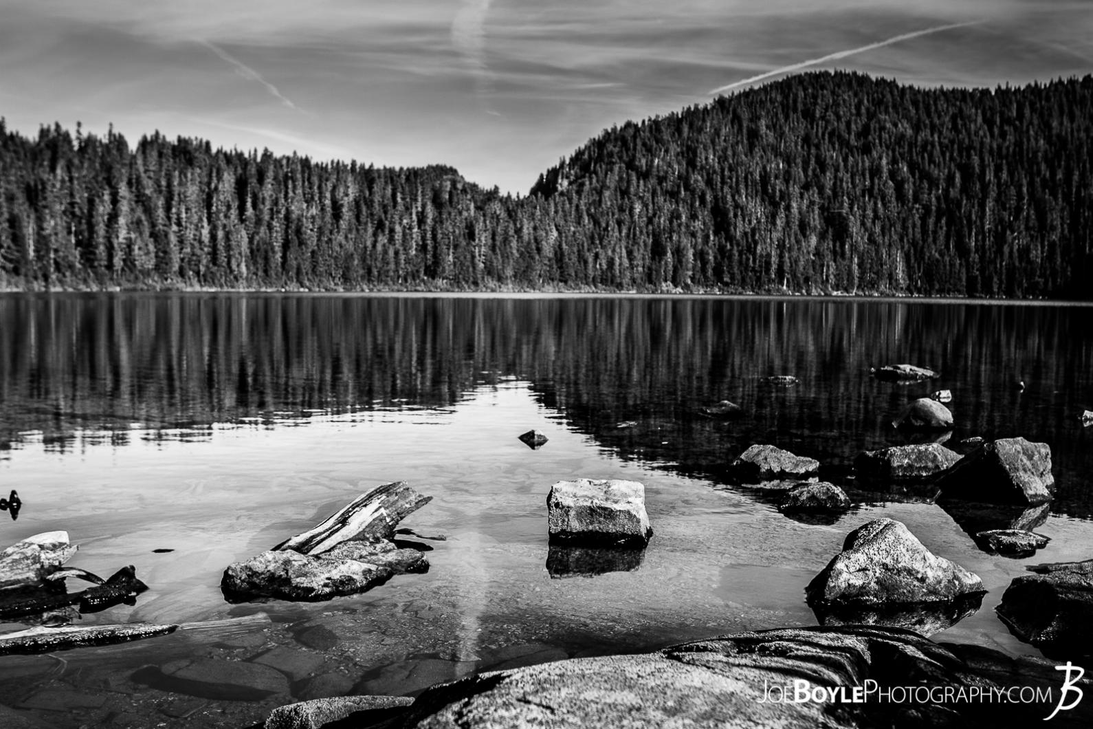 mowich-lake-with-rocks-on-the-shoreline-black-white