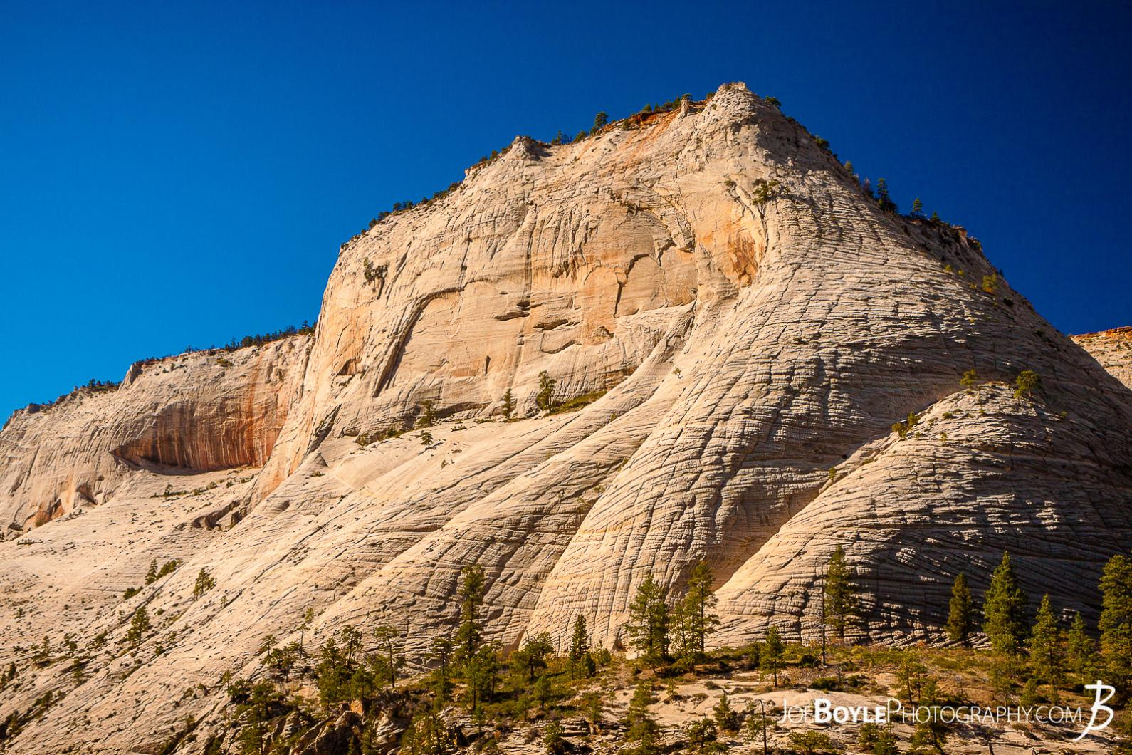 canyon-cliff-face-with-long-shadows-in-zion-national-park