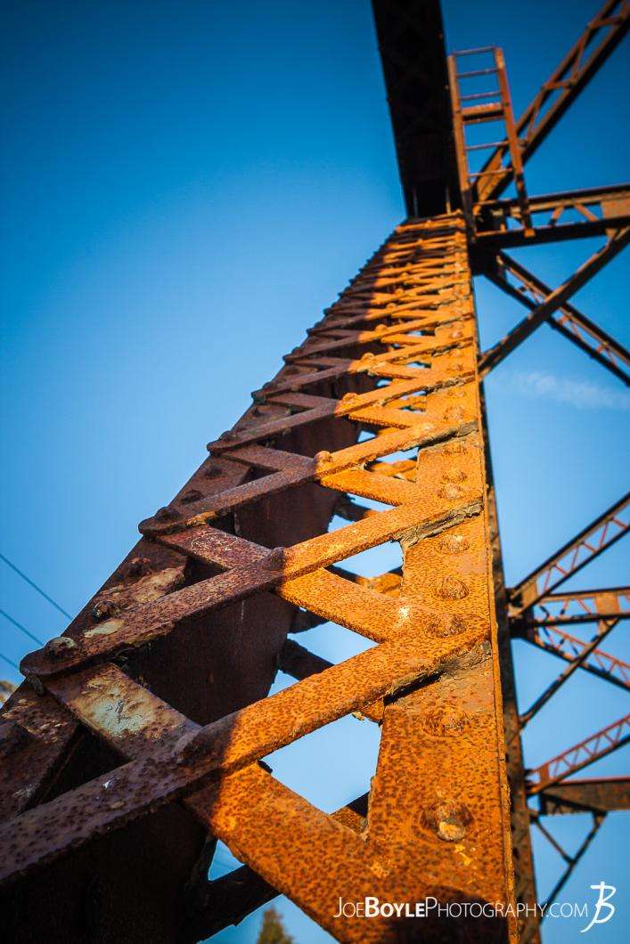 looking-up-an-iron-girder-pylon-on-a-train-bridge-color
