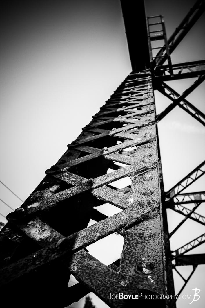 looking-up-an-iron-girder-pylon-on-a-train-bridge-black-and-white